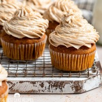 pumpkin spice latte cupcakes sitting on a wire rack