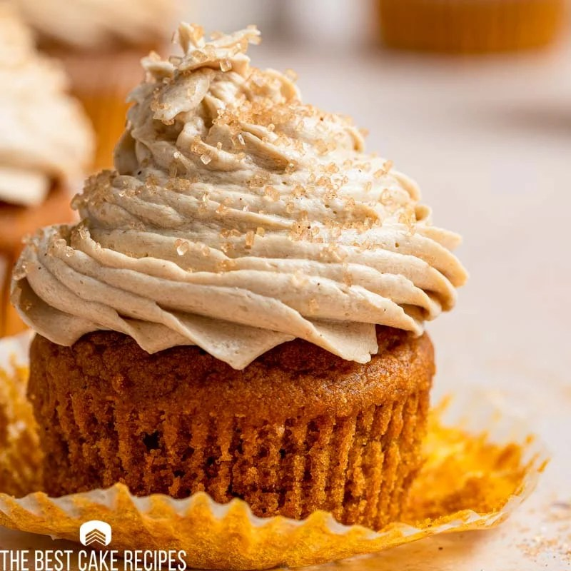 an unwrapped cupcake with coffee frosting