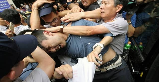 He was punched and held in a headlock by the angry crowd