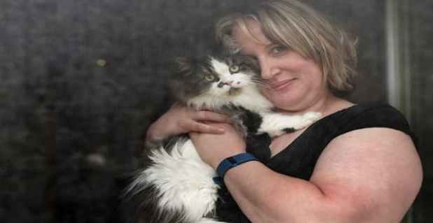 """Marnie Singer poses with her cat, Freddie. Singer runs the Winnipeg Missing and Found Cat Watch Facebook page and has helped reunite """"hundreds"""" of lost cats with their owners."""