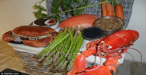The cat food contains, from clockwise: saffron, line-caught Scottish salmon, carrots, quinoa, Arenkha caviar, Norfolk lobster, organic asparagus, and locally-sourced Devon crab