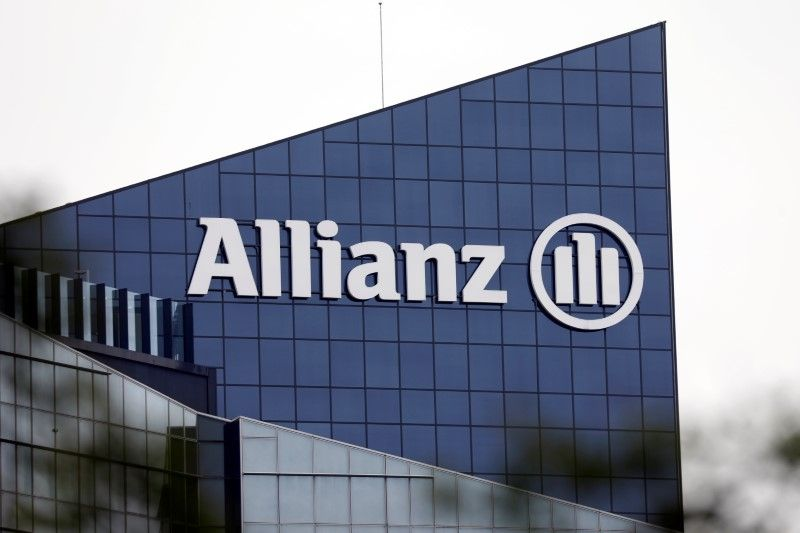 FILE PHOTO: The logo of insurer Allianz SE is seen on the company building in Puteaux at the financial and business district of La Defense near Paris