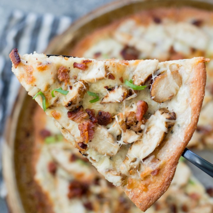 This easy Keto Chicken Bacon Ranch Pizza has a perfectly crispy low carb crust and is loaded with grilled chicken and bacon! Only 3 net carbs per slice! #keto #lowcarb