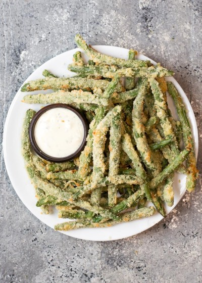 Try these low carb Crispy Green Bean Fries perfect for a game day snack! You can make these keto fries in the oven or air fryer!