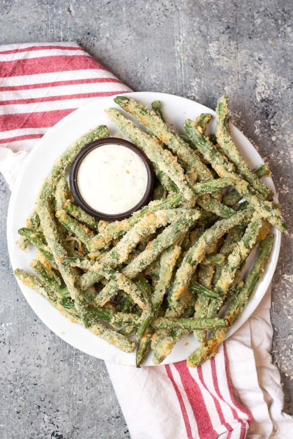 Try these low carb Crispy Green Bean Fries perfect for a game day snack! You can make these keto fries in the oven or air fryer!  #keto