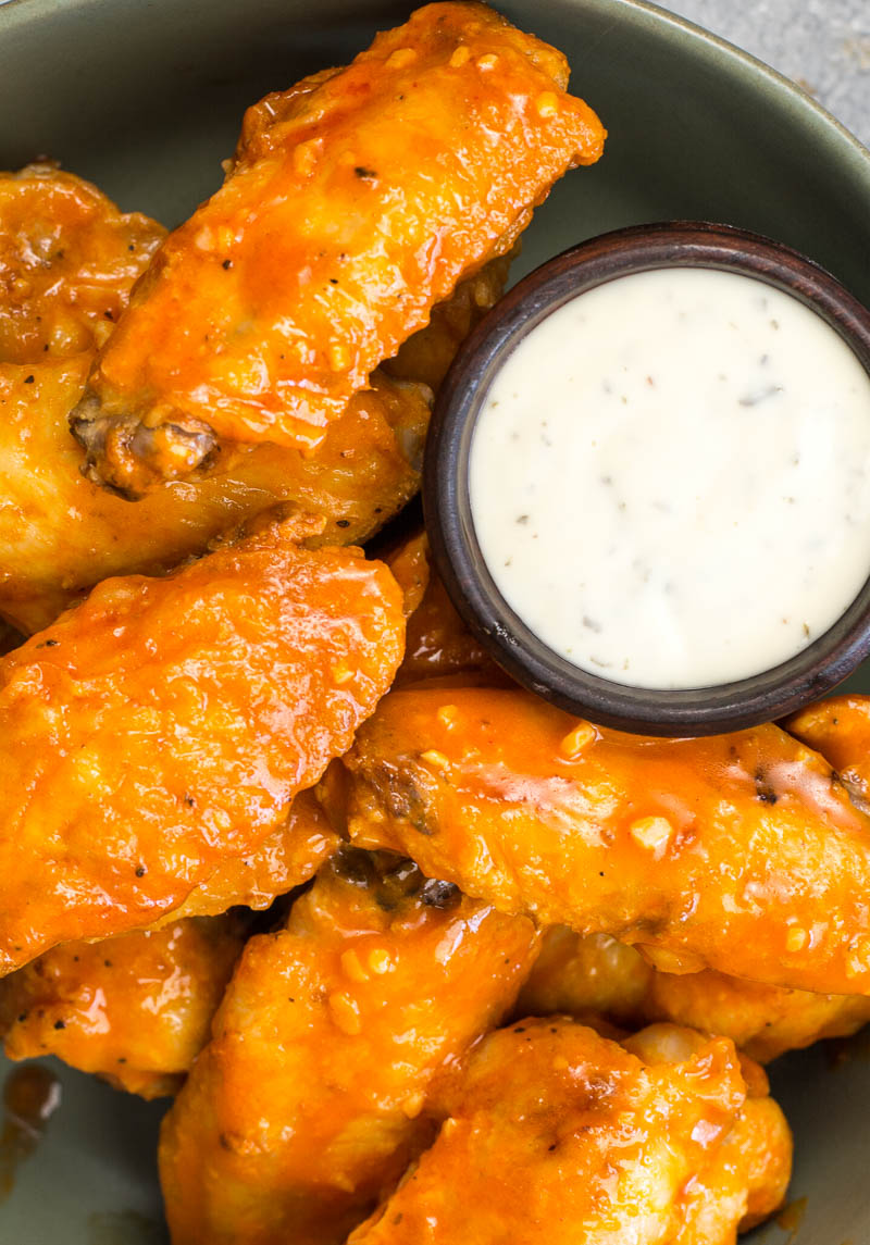 These Air Fryer Buffalo Wings are ultra crispy with no breading! These wings are the perfect low carb game day snack complete with a spicy, buttery buffalo sauce!