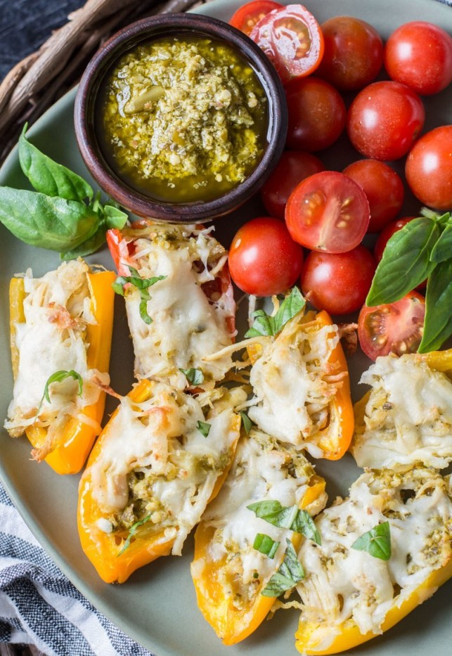 Keto Pesto Chicken Stuffed Sweet Peppers, a simple FOUR ingredient dinner that is healthy and gluten free! Under 6 net carbs per serving!