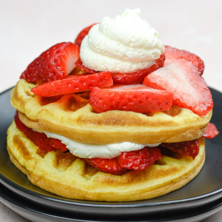 Enjoy a plateful of these Keto Strawberry Shortcake Waffles for about 5 net carbs each! This is the perfect low carb breakfast!