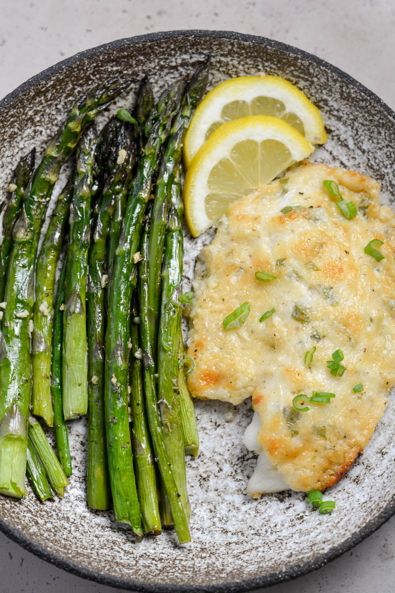 This Keto Parmesan Tilapia and Asparagus is the perfect low carb recipe for one! At only 3.8 net carbs per serving this 20 minute meal is the perfect keto recipe for busy nights!