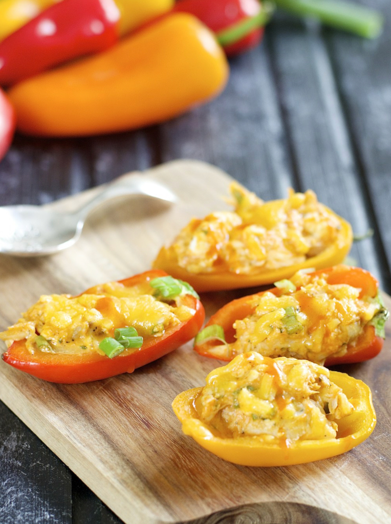 These Keto Buffalo Chicken Stuffed Peppers are packed with tender chicken, buffalo sauce and cheese! This is the perfect easy keto dinner or appetizer for about 5 net carbs per serving!