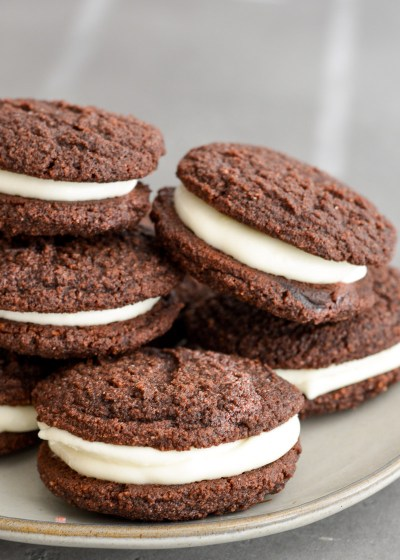 These Classic Keto Whoopie Pies feature a soft, chewy cookie with light and fluffy vanilla filling! These low carb treats are less than 5 net carbs each, and naturally gluten free!