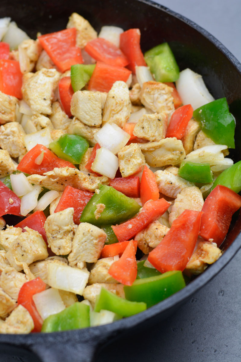 Try this Chicken Philly Cheesesteak Skillet packed with pan seared chicken, mushrooms, bell peppers and onions. This easy one pan recipe has less than 5 net carbs per serving!