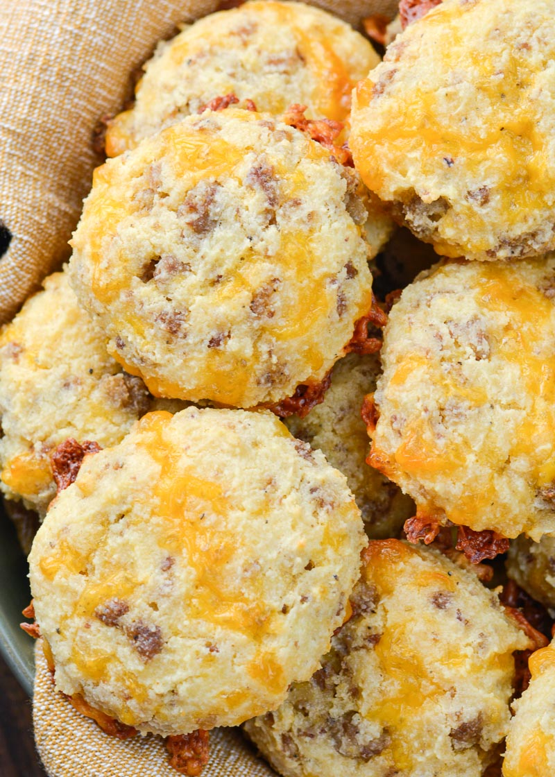 These Keto Sausage Cheddar Biscuits are loaded with flavor and have less than two net carbs each. Pair with scrambled eggs and enjoy the perfect keto breakfast!