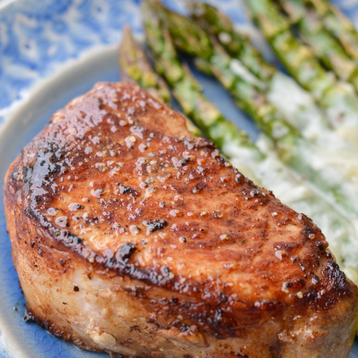 Learn exactly how to cook a thick cut pork chop so it is perfectly tender and juicy!