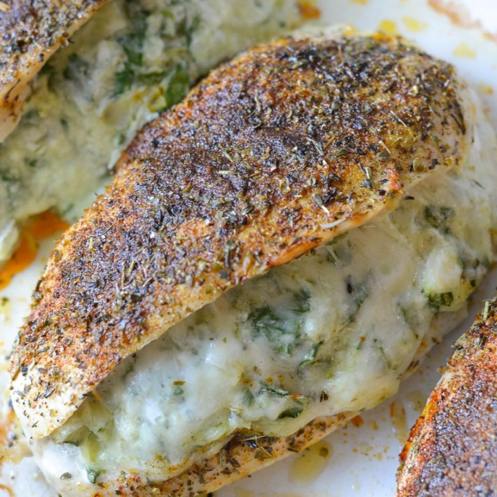 This low-carb Spinach Artichoke Stuffed Chicken is a keto 30-minute dinner dream! It's super juicy and mega flavorful--Even better, it all cooks in one pan and for easy cleanup!