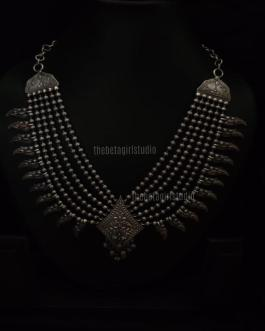 bead necklace with elegant center piece