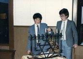Brothers lighting the Menorah