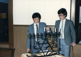 Brothers lighting the Menorah
