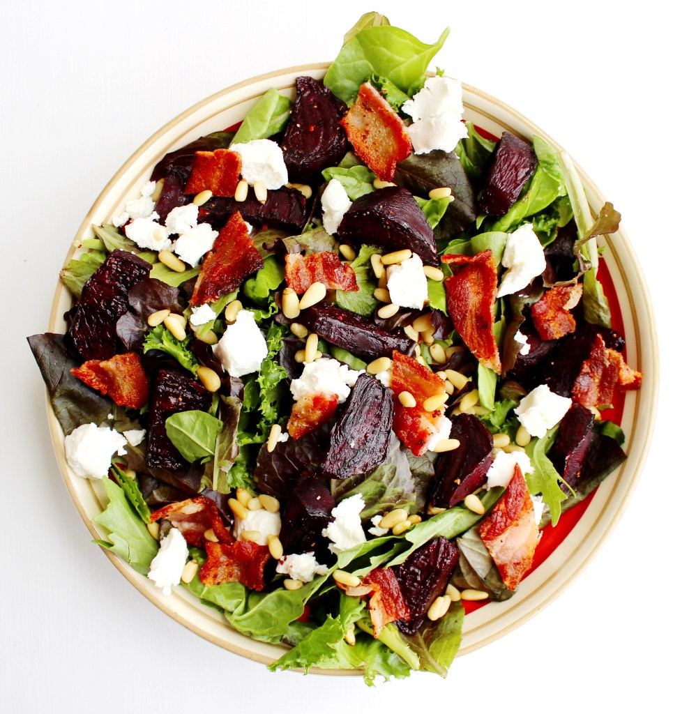 Bowl of Roasted Beet Salad with bacon, goat cheese and pine nuts