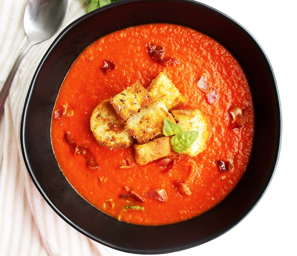 Tomato Basil Soup topped with Croutons, Crispy Pancetta and Basil