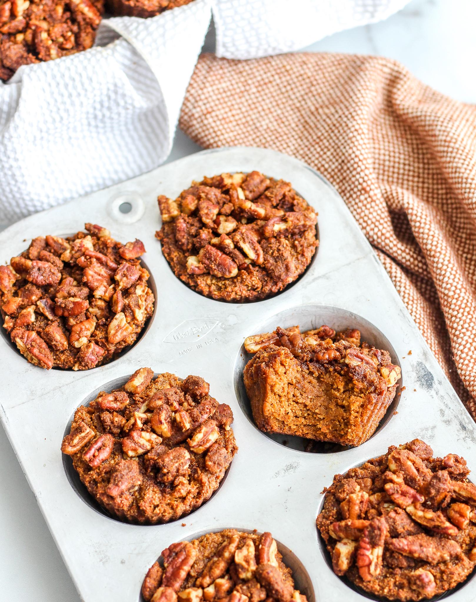 Paleo Pumpkin Streusel Muffins in a silver muffin tin