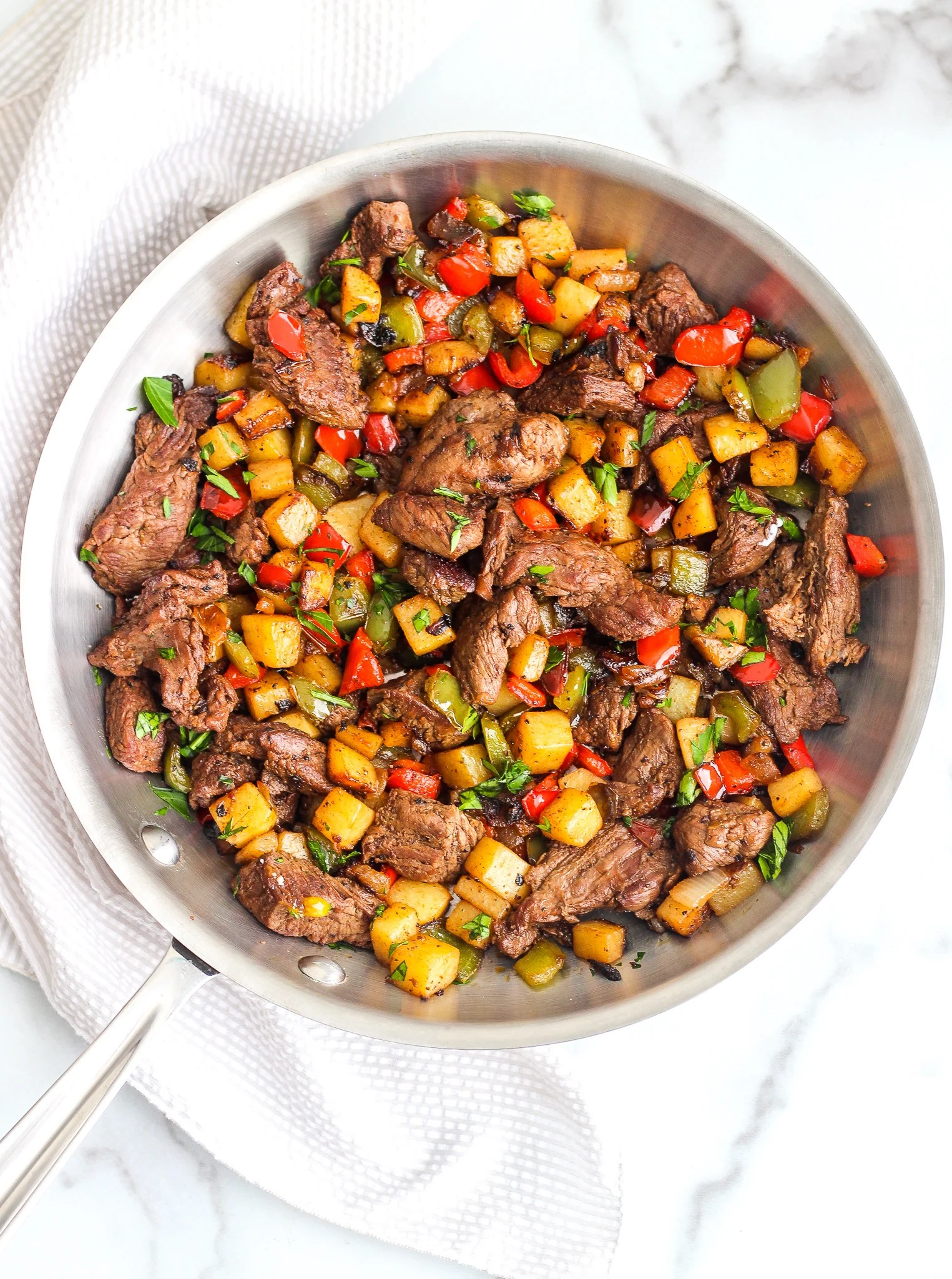 Whole30 Steak Breakfast Hash in a stainless steel skillet
