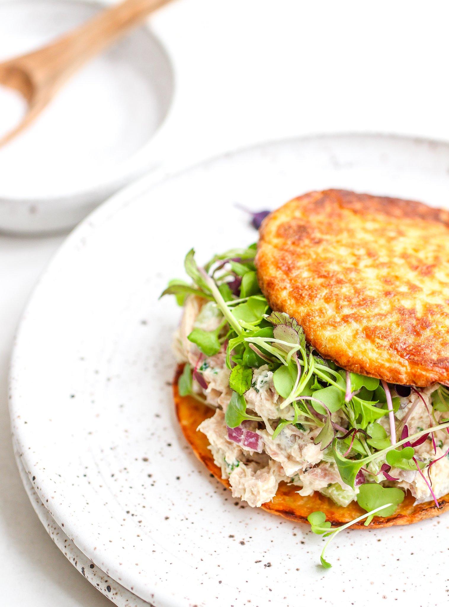 low carb tuna salad sandwich on toasted cauliflower thins with fresh micro greens