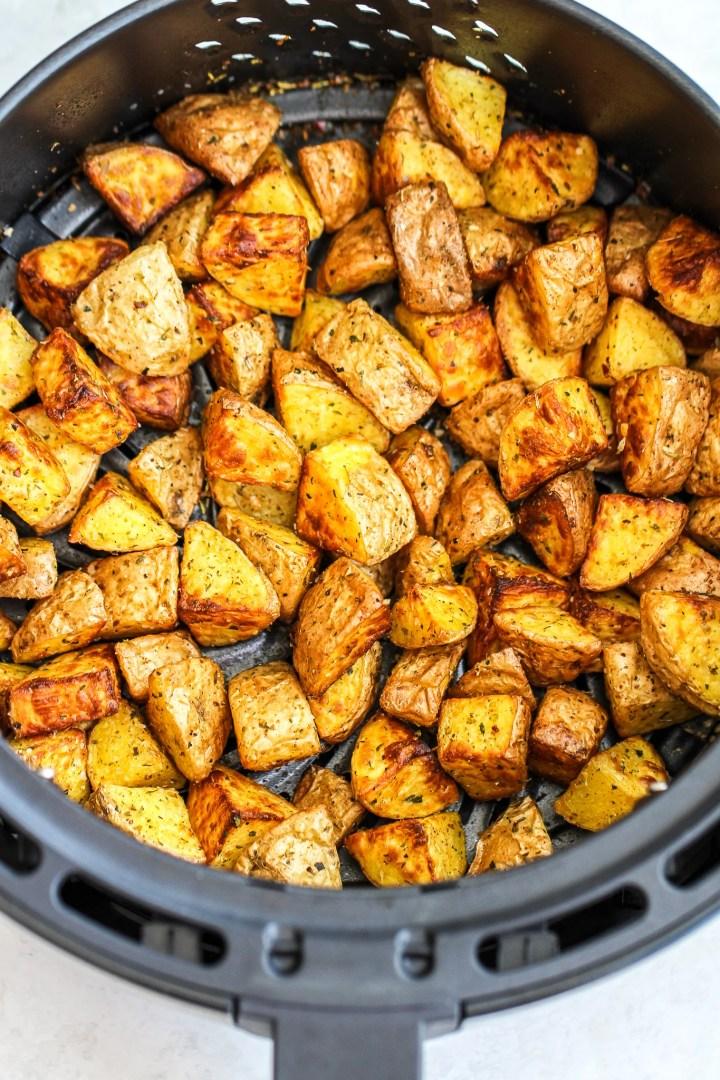 crispy potatoes in an air fryer basket