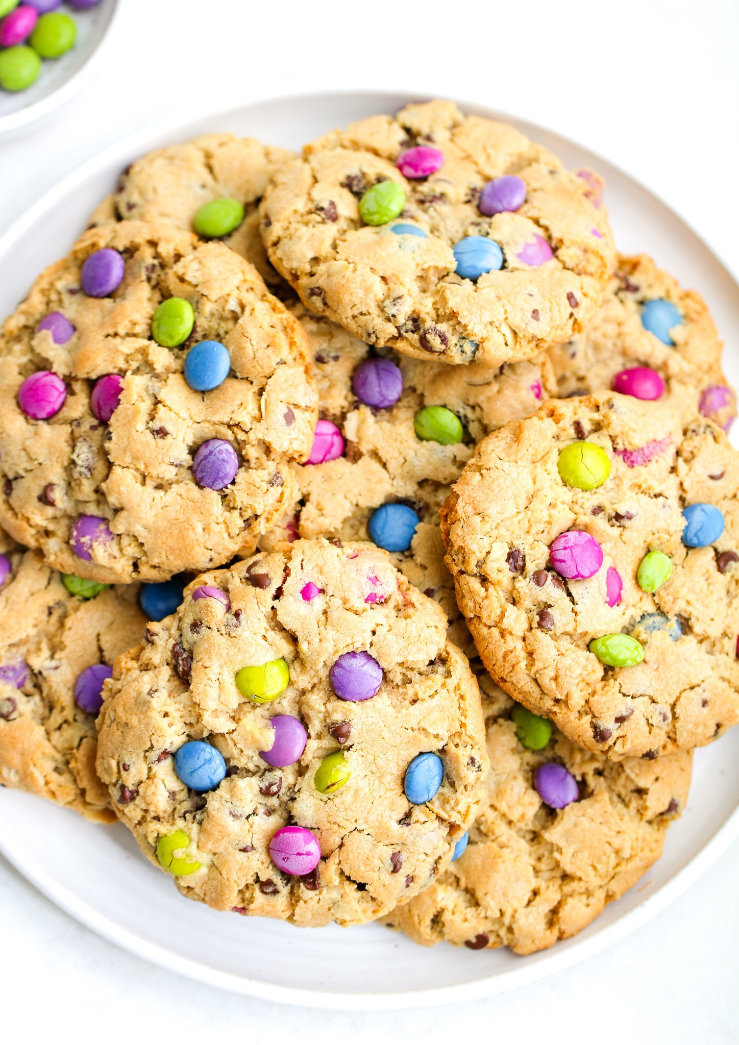 white serving plate loaded with gluten free monster cookies
