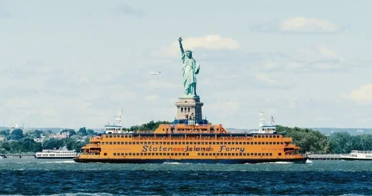 Staten Island ferry passing by Statue of Liberty