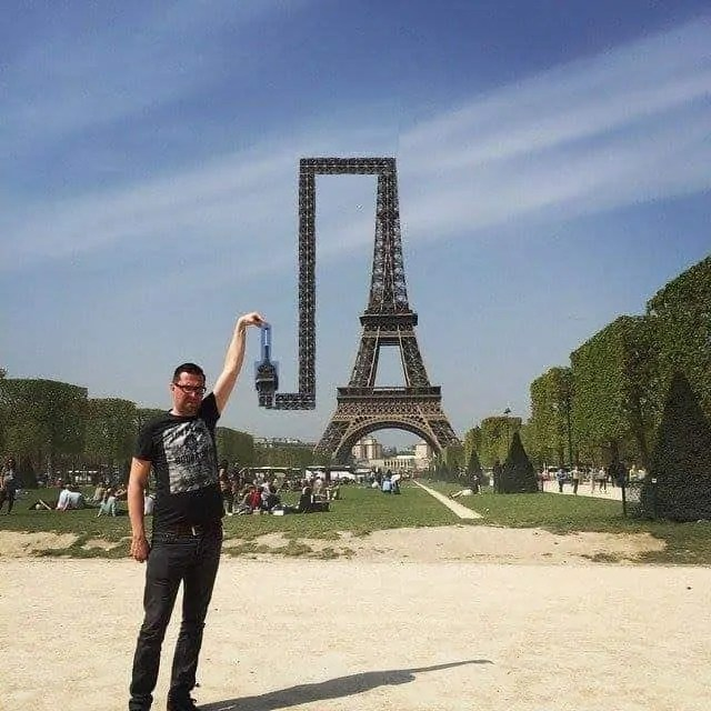 Eiffel Tower bends itself so that the finger can touch it
