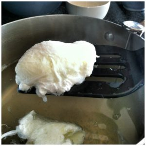 6. Using a slotted spoon or spatula, gently lift the eggs from the water bath, one at a time.