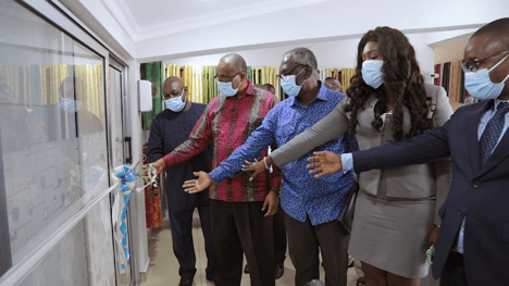 Clients join officials, Isaac Kyei-Mensah (left), Kofi Sekyere (second left), and George Blankson (third left) to cut the tape.