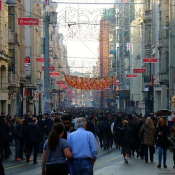 Istiklal Street, a mile-long gauntlet of restaurants, shops, cafes, bars and crowds crowds crowds. Three million people reportedly walk down it every day.