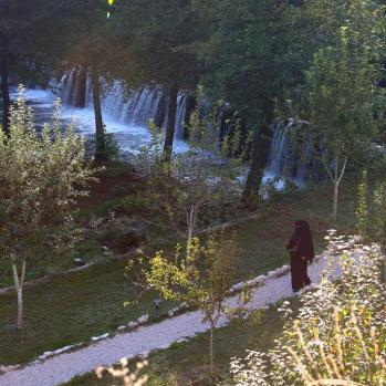 A niqab-clad woman by river - the first I have seen on this trip.