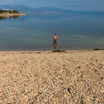 Man in lake.