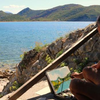 Painter on beach in small village called Buljarica, near Petrovac.