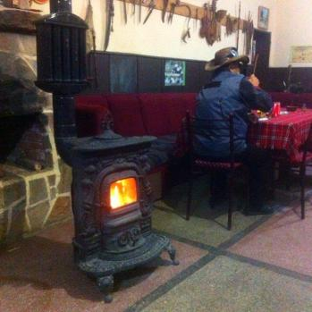 Saved from being eaten by jackals by a kindly truck driver, who takes me to charming guesthouse in Shtit complete with cowboy and woodburning stove.