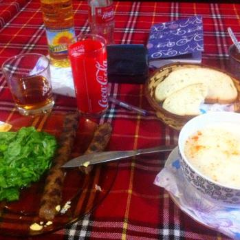 Dinner! A potent combo of my favourite paunch (tripe) soup, salad, Coke and Johnnie Walker.