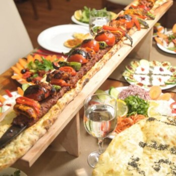 Metre-long Adana kebab served by restaurant (we don't actually eat this, but I feel reassured just knowing it exists in the world).