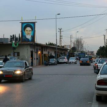 Approaching Sur as dusk begins to fall, overlooked by Ayatollah Khomenei himself. We're in Hezbollah territory now.