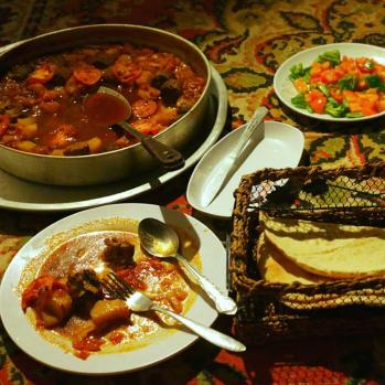 My feast of a dinner, including the biggest portion of stew I've ever eaten. I wolf it down like the beast I've become.