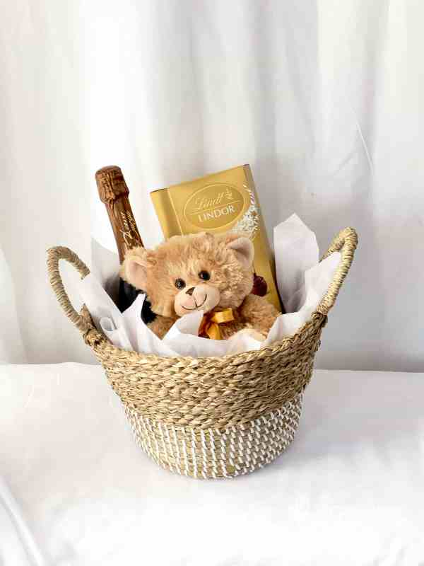 Example of Hampers and giftwares in a Seagrass Basket - Brown Teddy Bear, Lindor Chocolate, Grant Burge Sparkling Wine by The Big Flower Bouquet