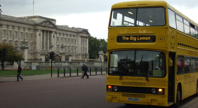 Our old double decker (now retired) outside Buckingham Palace during a London day trip