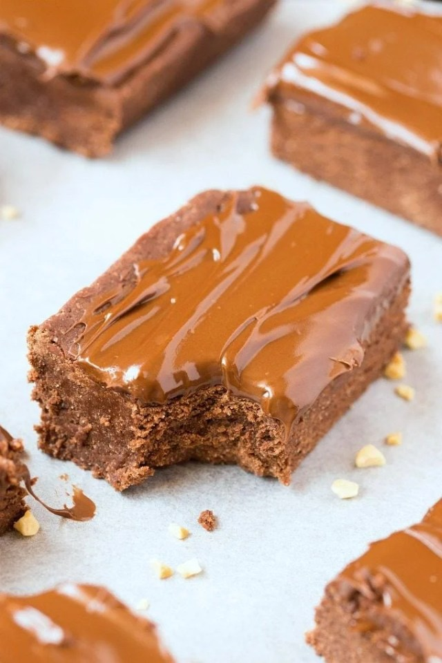 No Bake Chocolate Nutella Brownies perfect for breakfast! Paleo, Vegan, Keto and topped with a frosting!