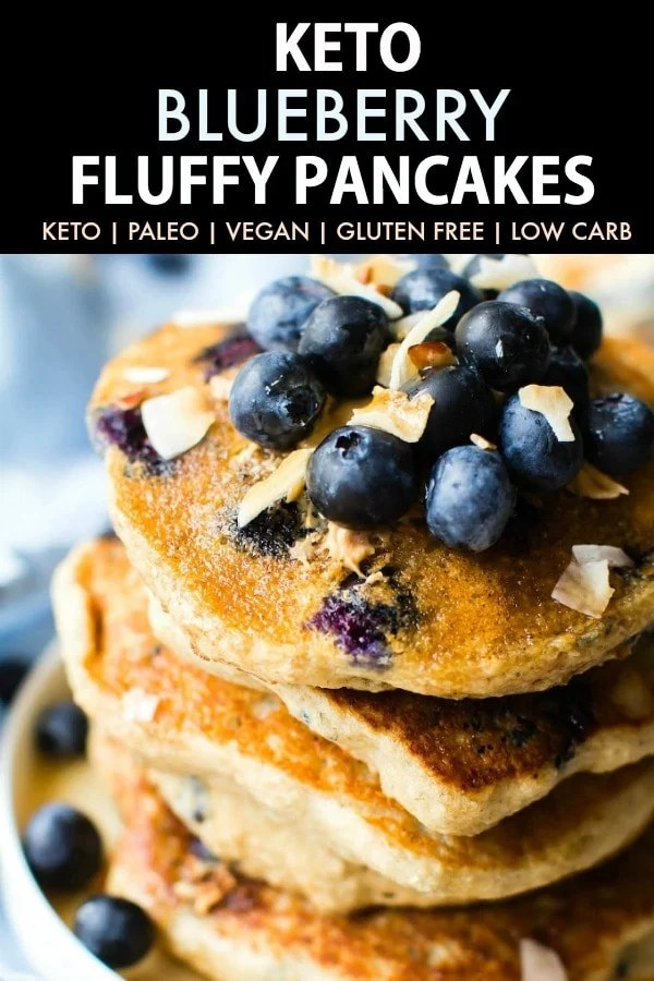 Fluffy Low Carb Keto Blueberry Pancakes topped with blueberries and coconut flakes