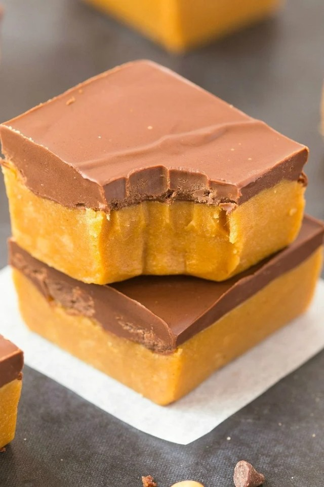 Healthy No Bake Pumpkin Fudge Bars stacked on top of one another.