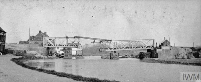 THE BRITISH EXPEDITIONARY FORCE ON THE WESTERN FRONT, 1914-1915 (Q 50293) Broken bridge over the canal near Erquinghem-Lys being repaired by Royal Engineers, 6th Division. April 1915. Copyright: © IWM. Original Source: http://www.iwm.org.uk/collections/item/object/205284108
