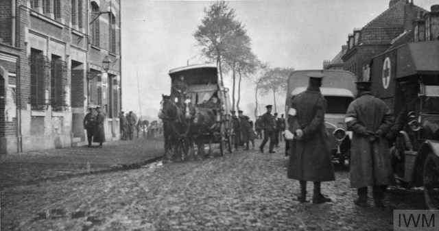 THE BRITISH EXPEDITIONARY FORCE ON THE WESTERN FRONT, 1914-1915 (Q 50290) Horse and motor ambulances beside the Mairie, Erquinghem-Lys, January 1915. 18th Field Ambulance, 6th Division. Copyright: © IWM. Original Source: http://www.iwm.org.uk/collections/item/object/205284105