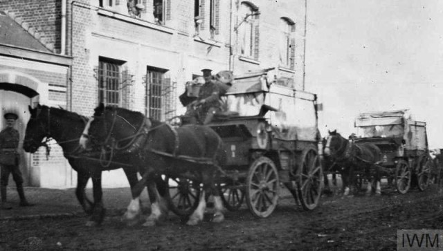 THE BRITISH EXPEDITIONARY FORCE ON THE WESTERN FRONT, 1914-1915 (Q 50289) Horse ambulances after discharging sick and wounded at the Mairie, Erquinghem-Lys; January 1915. 18th Field Ambulance, 6th Division. Copyright: © IWM. Original Source: http://www.iwm.org.uk/collections/item/object/205284104